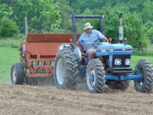 Tony Silvernail direct-seeds a small farm plot using a Tye seeder pulled by a coventional 4-wheeled tractor.